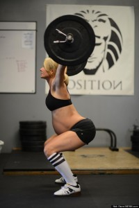 EXCLUSIVE Online storm rages after 8 1/2 month pregnant mum post photo of her weight lifting.